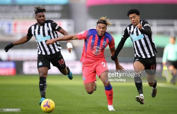 Reece James of Chelsea battles for possession with Jamal Lewis and Allan Saint-Maximin of Newcastle United during the Premier League match between...