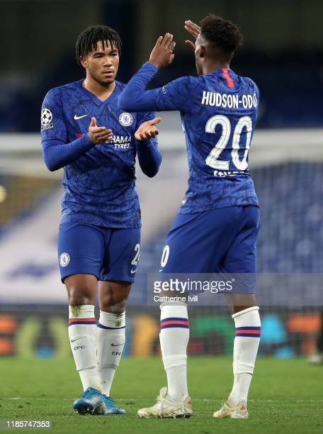 Reece James of Chelsea celebrates with teammate Callum HudsonOdoi following the UEFA Champions League group H match between Chelsea FC and AFC Ajax...