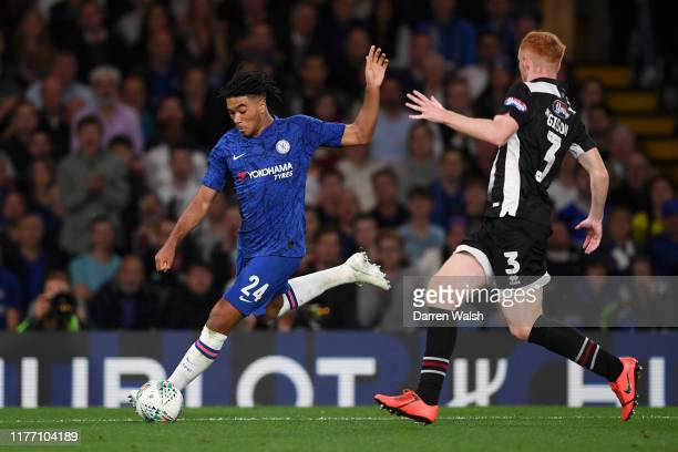 Reece James of Chelsea controls the ball as Liam Gibson of Grimsby Town looks on during the Carabao Cup Third Round match between Chelsea FC and...