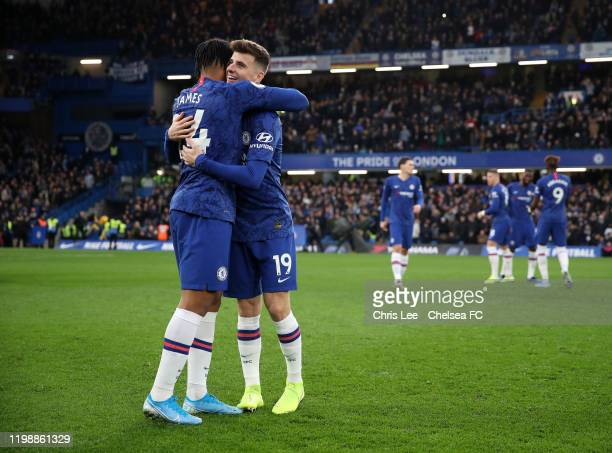 Reece James of Chelsea embraces Mason Mount of Chelsea after their sides victory in the Premier League match between Chelsea FC and Burnley FC at...