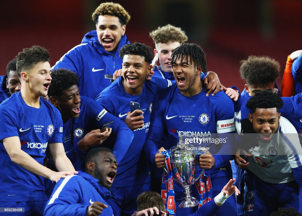 Reece James of Chelsea FC holds the trophy as his team celebrate winning the FA Youth Cup Final, second leg match between Arsenal and Chelsea at Emirates Stadium on April 30, 2018 in London, England.