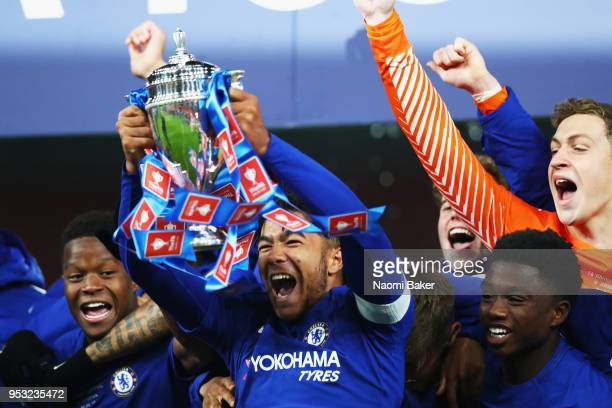 Reece James of Chelsea FC holds the trophy as his team celebrate winning the FA Youth Cup Final second leg match between Arsenal and Chelsea at...