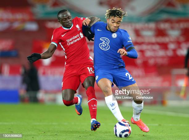 Reece James of Chelsea holds off a challenge from Sadio Mane of Liverpool during the Premier League match between Liverpool and Chelsea at Anfield on...