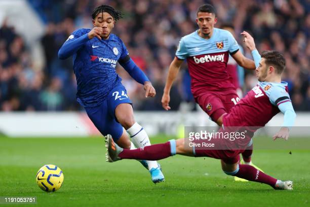 Reece James of Chelsea is challenged by Aaron Cresswell of West Ham United during the Premier League match between Chelsea FC and West Ham United at...