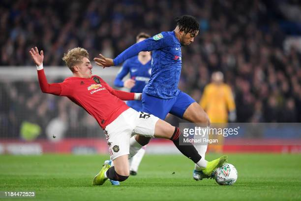 Reece James of Chelsea is challenged by Brandon Williams of Manchester United during the Carabao Cup Round of 16 match between Chelsea and Manchester...