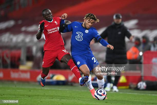 Reece James of Chelsea is challenged by Sadio Mane of Liverpool during the Premier League match between Liverpool and Chelsea at Anfield on March 04,...