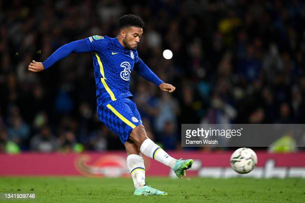 Reece James of Chelsea scores the winning penalty in the penalty shoot out during the Carabao Cup Third Round match between Chelsea and Aston Villa...