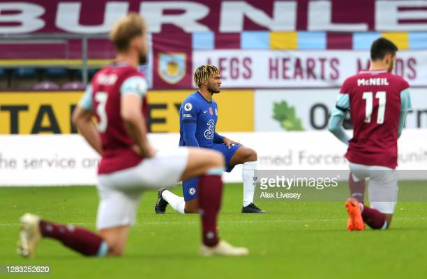 Reece James of Chelsea takes a knee in support of the Black Lives Matter Movement prior to the Premier League match between Burnley and Chelsea at...