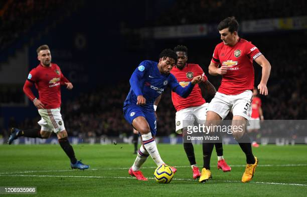 Reece James of Chelsea takes on Harry Maguire of Manchester United during the Premier League match between Chelsea FC and Manchester United at...