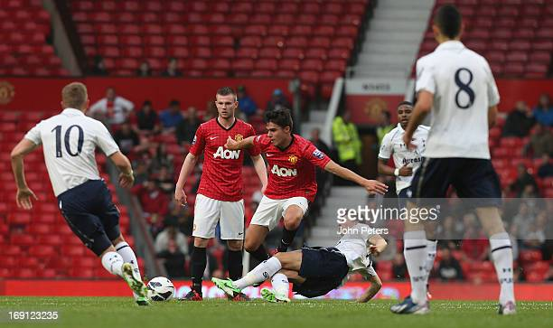 Reece James of Manchester United U21s in action with Tom Carroll of Tottenham Hotspur U21s during the Barclays U21s Elite Group Final between...