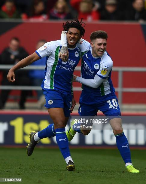 Reece James of Wigan Athletic celebrates after scoring his sides first goal with Josh WIndass of Wigan Athletic during the Sky Bet Championship match...