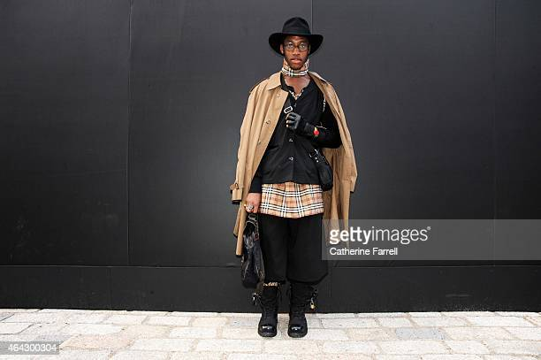 Reece Johnson Reece Johnson fashion design student and model wearing vintage trench coat from East London store self made Burberry check jute top Top...