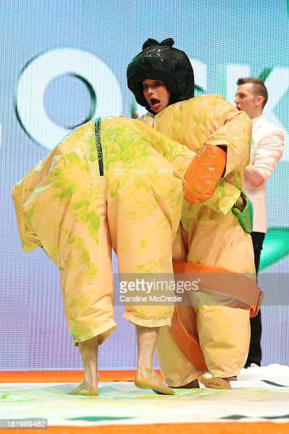 Reece Mastin and Rhiannon Fish compete in the 'Slime Sumo' during the Nickelodeon Slimefest 2013 matinee show at Sydney Olympic Park Sports Centre on...