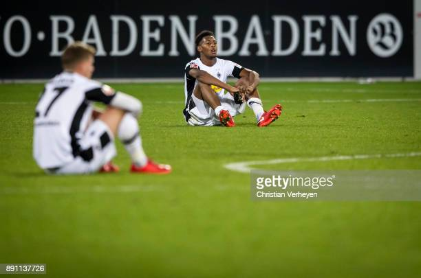 Reece Oxford and Michael Cuisance looks dejected after the Bundesliga match between SC Freiburg and Borussia Moenchengladbach at SchwarzwaldStadion...