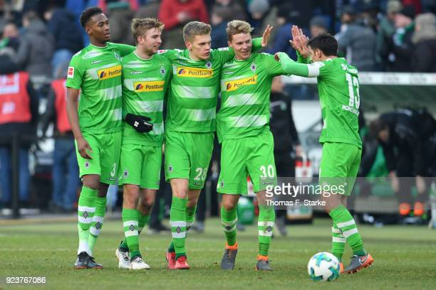 Reece Oxford Christoph Kramer Matthias Ginter Nico Elvedi and Lars Stindl of Moenchengladbach celebrate after winning the Bundesliga match between...