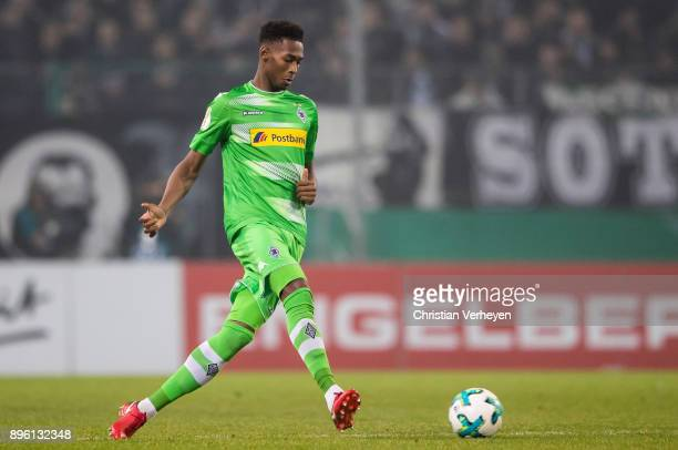 Reece Oxford of Borussia Moenchengladbach controls the ball during the DFBCup match between Borussia Moenchengladbach and Bayer 04 Leverkusen at...