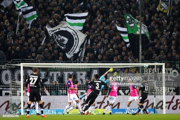 Reece Oxford of Borussia Monchengladbach hits the crossbar as Goalkeeper Christian Mathenia of Hamburg attempts the save during the Bundesliga match...