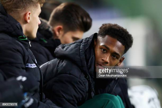 Reece Oxford of Borussia Monchengladbach looks on from the bench prior to the Bundesliga match between Borussia Moenchengladbach and FC Schalke 04 at...