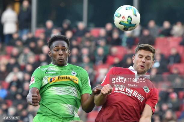 Reece Oxford of Moenchengladbach and Niclas Fuellkrug of Hannover head for the ball during the Bundesliga match between Hannover 96 and Borussia...