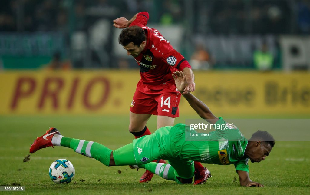 Reece Oxford of Moenchengladbach challenges Admir Mehmedi of Bayer Leverkusen during the DFB Cup match between Borussia Moenchengladbach and Bayer Leverkusen at Borussia-Park on December 20, 2017 in Moenchengladbach, Germany.