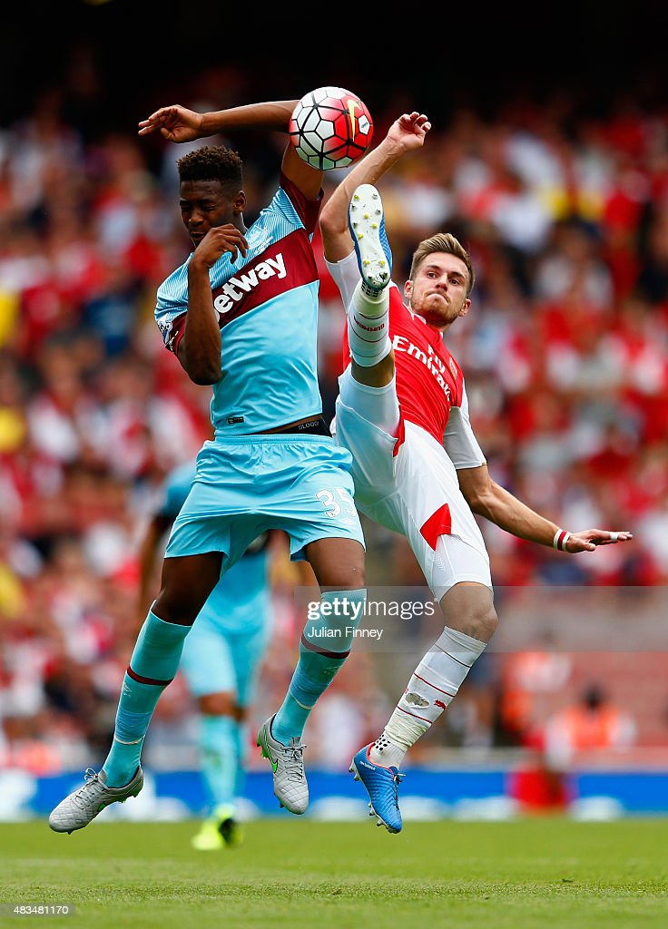 Reece Oxford of West Ham United and Aaron Ramsey of Arsenal battle for the ball during the Barclays Premier League match between Arsenal and West Ham United at the Emirates Stadium on August 9, 2015 in London, England.