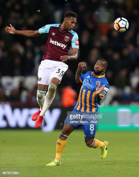 Reece Oxford of West Ham United and Abu Ogogo of Shrewsbury Town during the Emirates FA Cup Third Round Repaly match between West Ham United and...