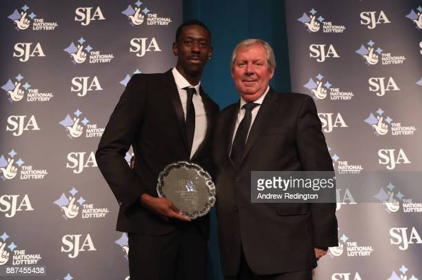 Reece Prescod receives The Peter Wilson Trophy for international newcomer from Brendan Foster during The SJA British Sports Awards 2017 at the Tower...