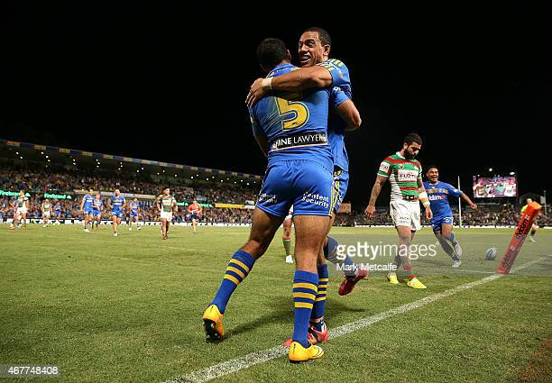 Reece Robinson of the Eels celebrates scoring a try with team mate Will Hopoate during the round four NRL match between the Parramatta Eels and the...