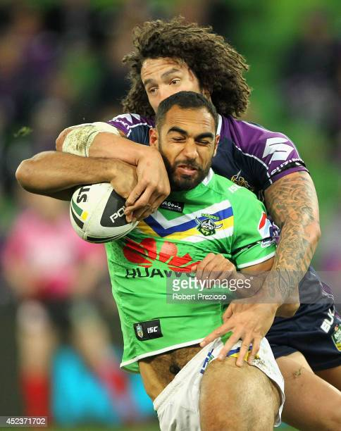Reece Robinson of the Raiders is tackled by Kevin Proctor of the Storm during the round 19 NRL match between the Melbourne Storm and the Canberra...