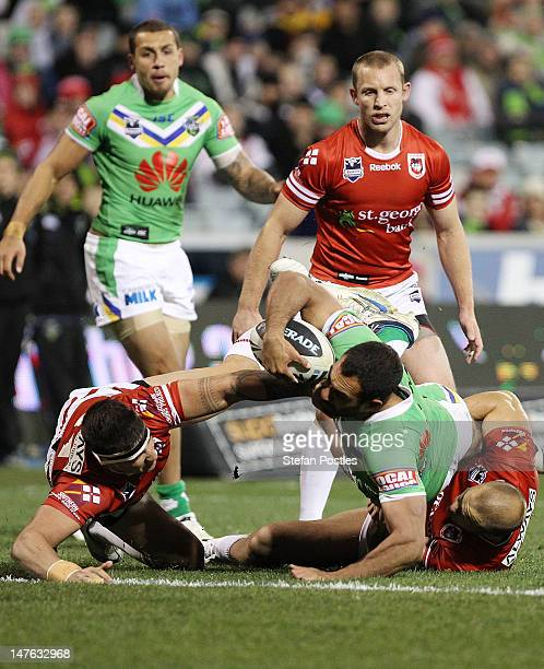 Reece Robinson of the Raiders scores a try during the round 17 NRL match between the Canberra Raiders and the St George Dragons at Canberra Stadium...