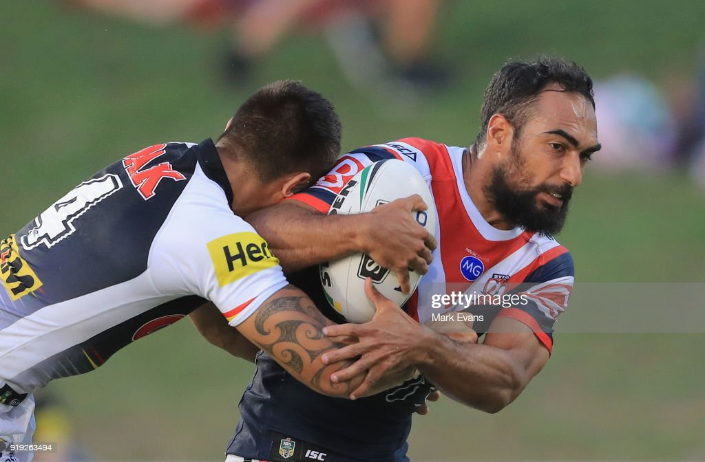 Reece Robinson of the Roosters (R) is tackled by Dean Whare of the Panthers during the NRL trial match between the Penrith Panthers and the Sydney Roosters at Penrith Stadium on February 17, 2018 in Sydney, Australia.