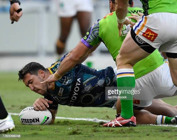 Reece Robson of the Cowboys scores a try during the round 12 NRL match between the North Queensland Cowboys and the Canberra Raiders at QCB Stadium...