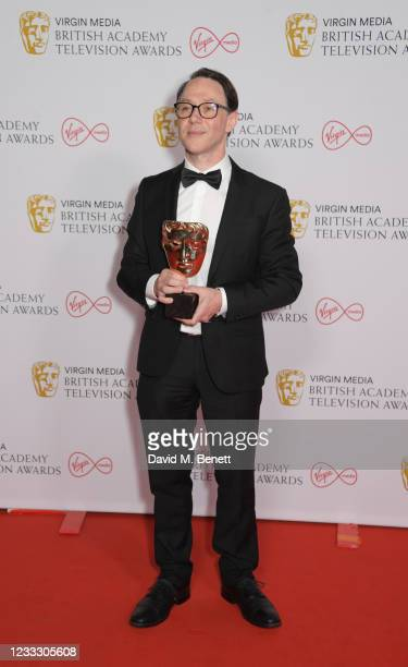 """Reece Shearsmith, accepting the Scripted Comedy award for """"Inside No. 9"""", poses in the Winners Room at the Virgin Media British Academy Television..."""