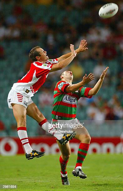 Reece Simmonds of the Dragons and Ahmad Bajouri of the Rabbitohs jump for a high ball during the NRL Charity Shield game between the South Sydney...