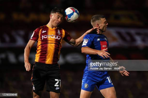 Reece Staunton of Bradford City and Jack Muldoon of Harrogate Town during the Sky Bet League Two match between Bradford City and Harrogate Town at...