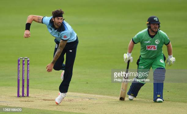 Reece Topley of England bowls past Paul Stirling during the second One Day International between England and Ireland at the Ageas Bowl on August 01,...