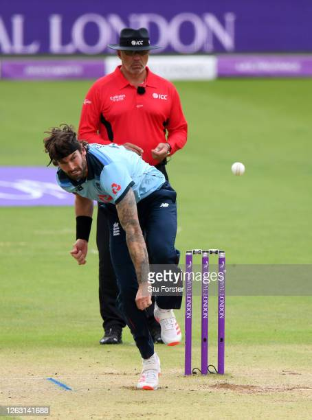 Reece Topley of England bowls watched on by Umpire David Millns during the Second One Day International between England and Ireland in the Royal...