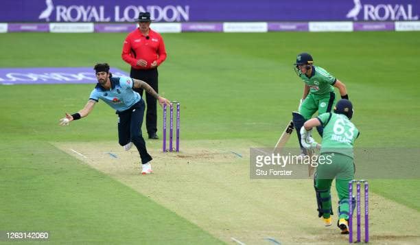 Reece Topley of England fields off his own bowling during the Second One Day International between England and Ireland in the Royal London Series at...