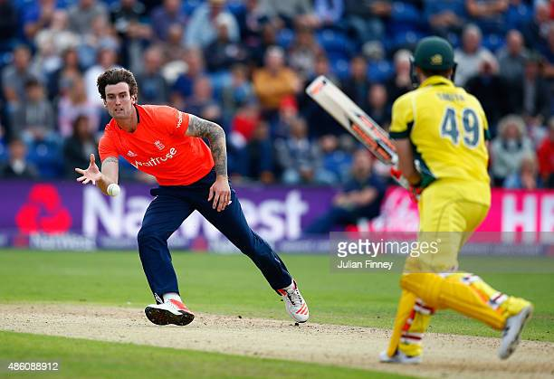 Reece Topley of England stops a shot by Steve Smith of Australia during the NatWest T20 International match between England and Australia at SWALEC...