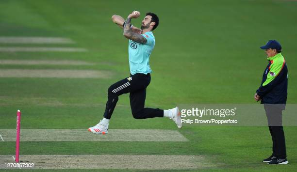 Reece Topley of Surrey bowls past umpire Ian Gould during the Vitality T20 Blast match between Surrey and Middlesex at The Kia Oval on September 05,...