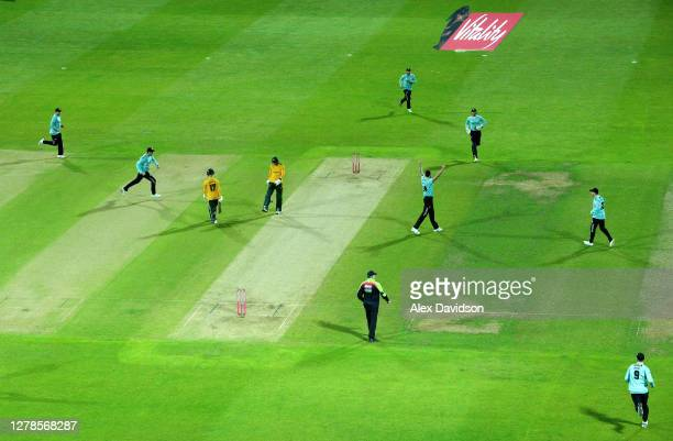 Reece Topley of Surrey celebrates the wicket of Alex Hales with teammates during the Vitality Blast 20 Final between Surrey and Notts Outlaws at...