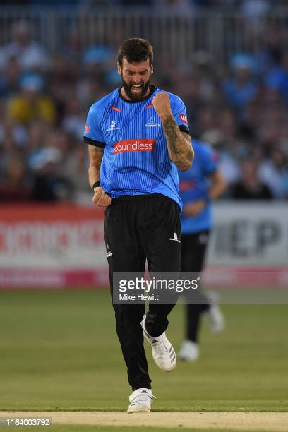 Reece Topley of Sussex celebrates after dismissing Aneurin Donald of Hampshire during the Vitality Blast match between Sussex Sharks and Hampshire at...