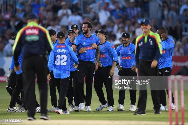 Reece Topley of Sussex is centre of attention after dismissing Sam Northeast of Hampshire during the Vitality Blast match between Sussex Sharks and...