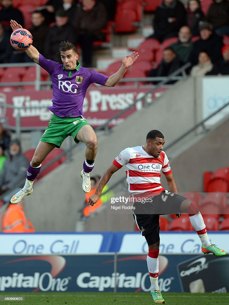 Reece Wabara (R) of Doncaster Rovers challenges Joe Bryan of Bristol City during the FA Cup Third Round match between Doncaster Rovers and Bristol City at Keepmoat Stadium on January 3, 2015 in Doncaster, England.