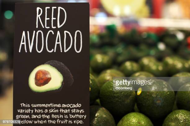 Reed avocados sit on display for sale A sign alerts during the grand opening of a Whole Foods Market Inc location in Burbank California US on...