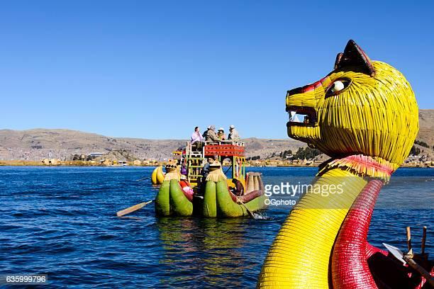 Reed boat carrying tourists on Lake Titicaca, Peru