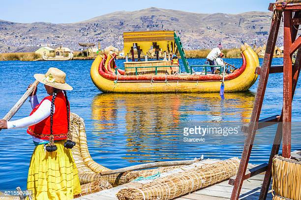 Reed boat in Puno, Peru with indigenous people
