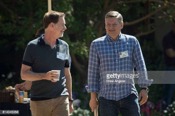 Reed Hastings, co-founder and chief executive officer of Netflix, and Ted Sarandos, chief content officer of Netflix, attend the third day of the...
