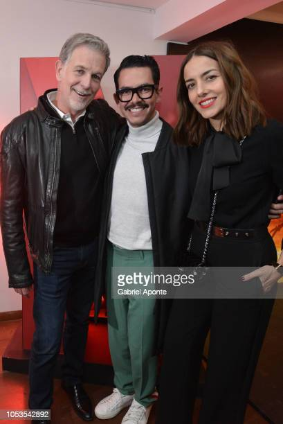 Reed Hastings Manolo Caro and Cecilia Suárez pose during Casa Netflix Cocktail Party at Galeria Cero on October 9 2018 in Bogota Colombia