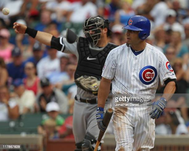 Reed Johnson of the Chicago Cubs looks back at the pitcher after striking out in the 9th inning as A.J. Pierzynski of the Chicago White Sox throws...